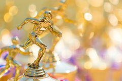 Close up of track and field running trophy. With shallow depth of field, blurred foreground and background, room for copy space stock photography