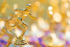 Close up of track and field running trophy with shallow depth of. Field, blurred foreground and background, room for copy space royalty free stock images