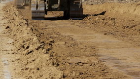 Close up of tracked bulldozers at work.  stock video footage