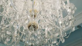 Close up tracking shot expensive old style glass diamonds chandelier stock video