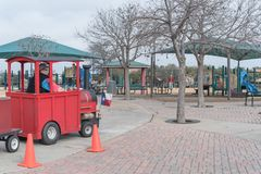 Kid trackless train ride in public winter event in Irving, Texas. Close-up trackless train ride wagon waiting at station in public park winter event in Irving Stock Photo