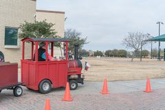 Kid trackless train ride in public winter event in Irving, Texas. Close-up trackless train ride wagon waiting at station in public park winter event in Irving Stock Images