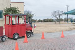 Kid trackless train ride in public winter event in Irving, Texas. Close-up trackless train ride wagon waiting at station in public park winter event in Irving Royalty Free Stock Photo