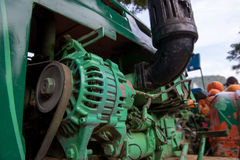 Close-up of tractor engine. Close-up detail of a green tractor engine. Agricultural vehicles and industry concept Stock Photos