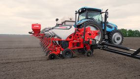 Close-up, tractor with special precision planters, seeder is working in the field, agricultural machinery is planting stock video footage
