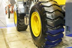 Close up of tractor tire, selective focus. Modern Tractor Close-Up.  Stock Photography