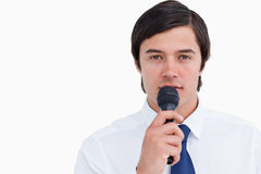 Close up of tradesman with microphone Stock Photography