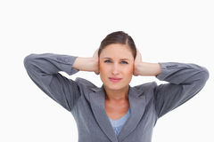 Close up of tradeswoman covering ears Stock Photo