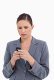 Close up of tradeswoman reading text message Royalty Free Stock Photos