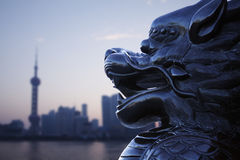 Close-up of traditional Chinese statue with Shanghai skyline in the background Stock Photos