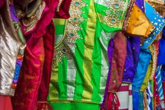 Close up of traditional colorful embroidered indian sarees stock images