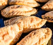 Close up of traditional empanadas at a street food market. Close up of traditional empanadas at street food market stock images