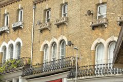 Close-up on traditional facades with brickstone and wrought iron railing balconies in Swanage Royalty Free Stock Images