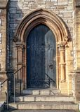 Close-up of traditional gothic medieval wooden entrance door way with ancient brick arc royalty free stock photos