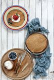 Close-up of Traditional homemade pancakes in plates on white background. Celebration of Maslenitsa. Top view stock photos
