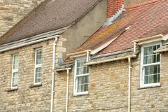 Close-up on traditional houses with brickstone and flagstone roofs in Swanage Stock Photos