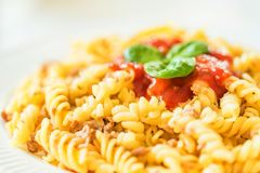 Traditional Italian pasta or fussili bolognese. Close-up of traditional Italian spaghetti or fusilli with bolognese sauce on wooden background Stock Photo