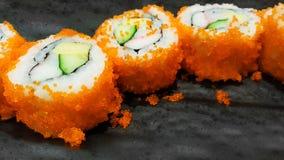 Close-up traditional japanese sushi rolls tobiko flying fish ro Royalty Free Stock Image