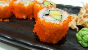 Close-up traditional japanese sushi rolls tobiko flying fish ro Stock Photo