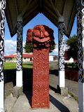 Close up of Traditional Maori Wooden carved sculpture new zealand Royalty Free Stock Photos