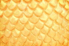 Close up traditional naga scale stucco patterns texture in Thai temple , Gold abstract background royalty free stock photo