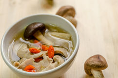 Close up Traditional oriental pork broth with shiitake mushrooms Stock Photos