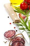 Traditional sliced meat sausage salami and vegetables Stock Photography