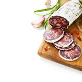 Traditional sliced meat sausage salami on wooden board Royalty Free Stock Images