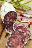 Traditional sliced meat sausage salami on wooden board Royalty Free Stock Photo