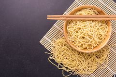 Traditional Thai yellow noodle on black stone table background. Close up traditional Thai yellow noodle on black stone table background Royalty Free Stock Photos