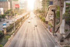Close-up of traffic camera observes vehicular traffic on a road royalty free stock photos