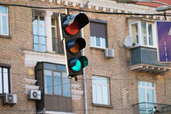Close-up of traffic light front of buildings of downtown Stock Photos