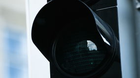 Close-up of traffic light turn green at the daytime. Picture of illuminated green traffic lense light. stock video footage