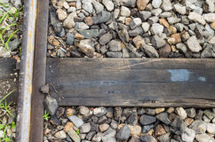Close up of train track, spike, and wooden railroad tie. Royalty Free Stock Photography