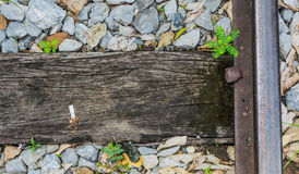 Close up of train track, spike, and wooden railroad tie. Stock Image