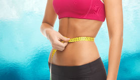 Close up trained belly with measuring tape Stock Images