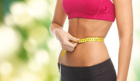 Close up trained belly with measuring tape Royalty Free Stock Photo