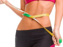 Close up of trained belly with measuring tape Royalty Free Stock Photo