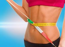 Close up of trained belly with measuring tape Stock Photo