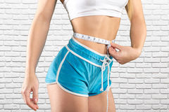 close up of trained belly with measuring tape Stock Image