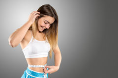 Close up of trained belly with measuring tape Stock Photos