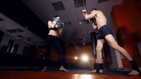 The close-up of the training with focus mitts. 4K. The close-up of the training with focus mitts stock footage