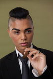 Close up of transgender woman holding cigarette Stock Image