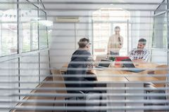 Young independent workers sharing the facilities of a modern co-working space royalty free stock photos