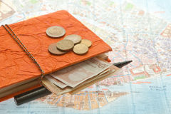 Close-up Travel Arrangement of Euro money, Map and notepad Royalty Free Stock Image