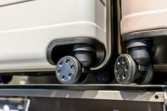 Close-up of travel case plastic wheels on display shelf. In store Royalty Free Stock Images