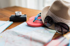 Close up of travel map, flip-flops, hat and camera Royalty Free Stock Photos