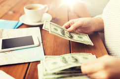 Close up of traveler hands counting dollar money Royalty Free Stock Images