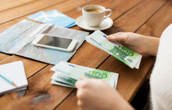 Close up of traveler hands counting euro money Royalty Free Stock Image