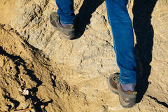 Close-up of traveler`s feet walking uphill on mountain and sand. Dune - travel, vacation,recreation and adventure concept Stock Photography